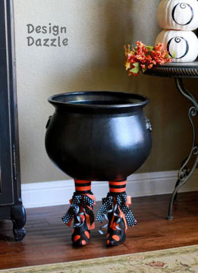 Cauldron for Halloween candy made with Witches feet.