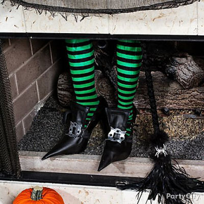 DIY witches Feet Fireplace decoration.
