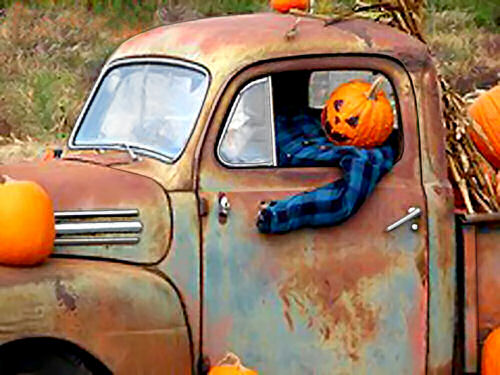 Old truck with Jack o lantern driver