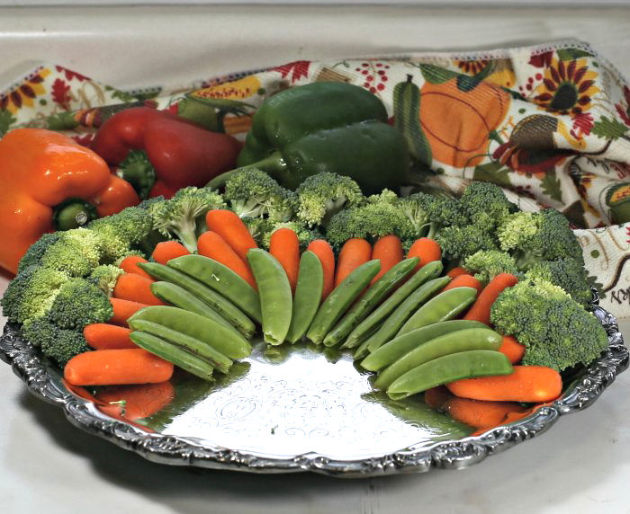 carrots and peas layered on broccoli florets
