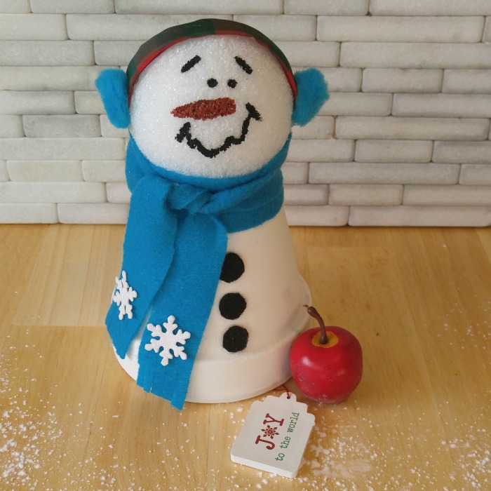 This adorable clay pot snowman makes a nice addition to my collection.