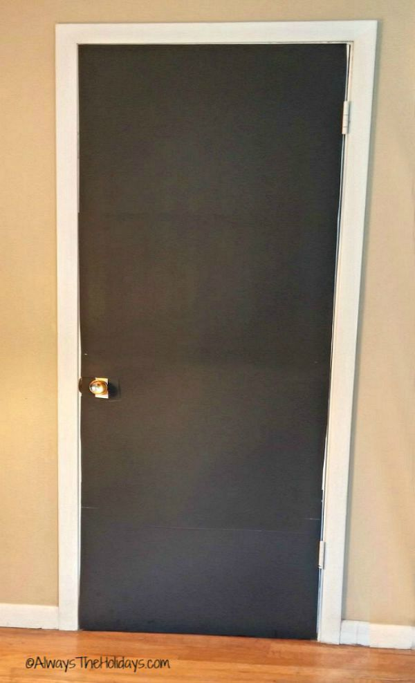 Cover the door with black poster board