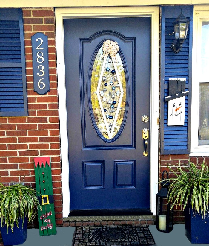 This Christmas ornament door hanger is perfect for front doors that have an oval glass panel in them. This type of door makes a round wreath look odd.