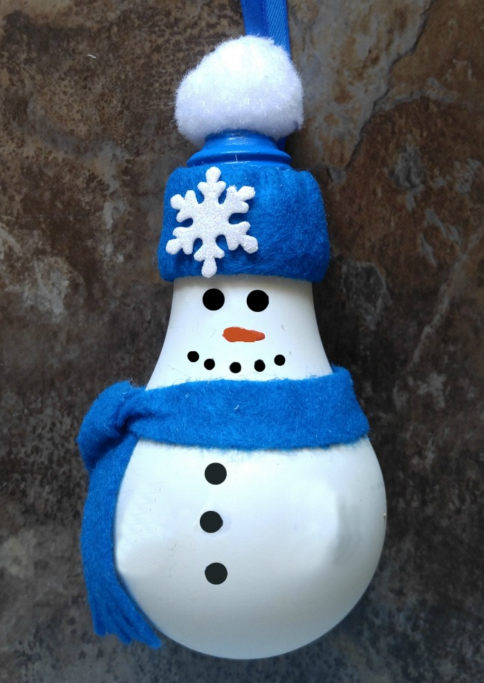 The snowman is ready for his mittens!