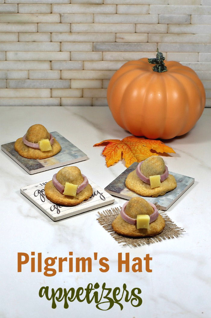 Appetizers with pumpkin and leaves and words reading Pilgrim's Hat appetizers.'