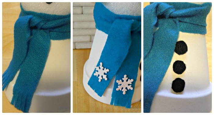 Use felt to make a scarf and coal and add snowflake stickers to the scarf ends. What a fun terracotta Christmas project!