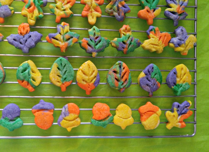 Thanksgiving autumn leaf cookies cooling on a wire rack.