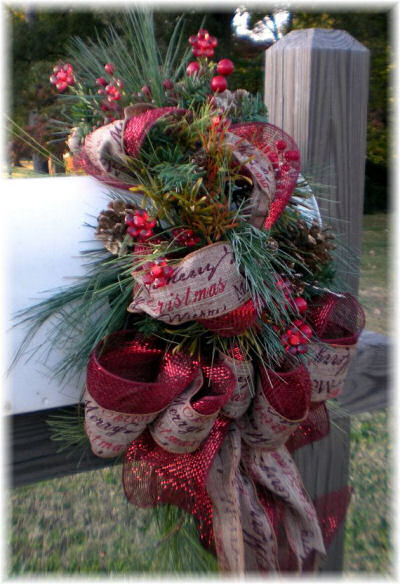 Festive Mailbox swag with burlap ribbon from https://www.etsy.com/shop/3SeasonDesign