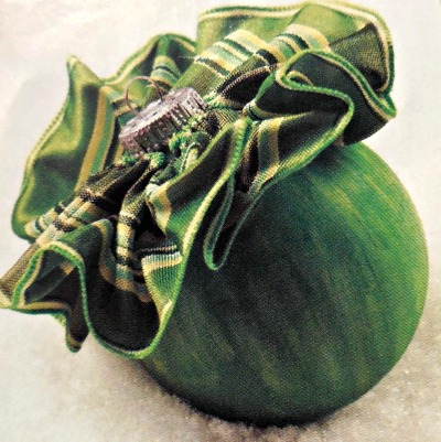 Painted ornament with a ruffled top.