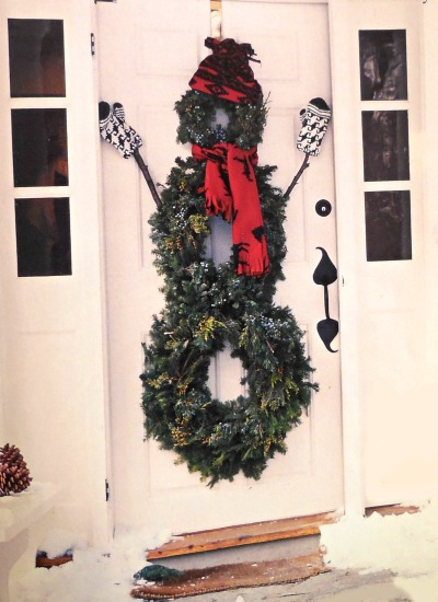 Three wreaths formed into a snowman decoration