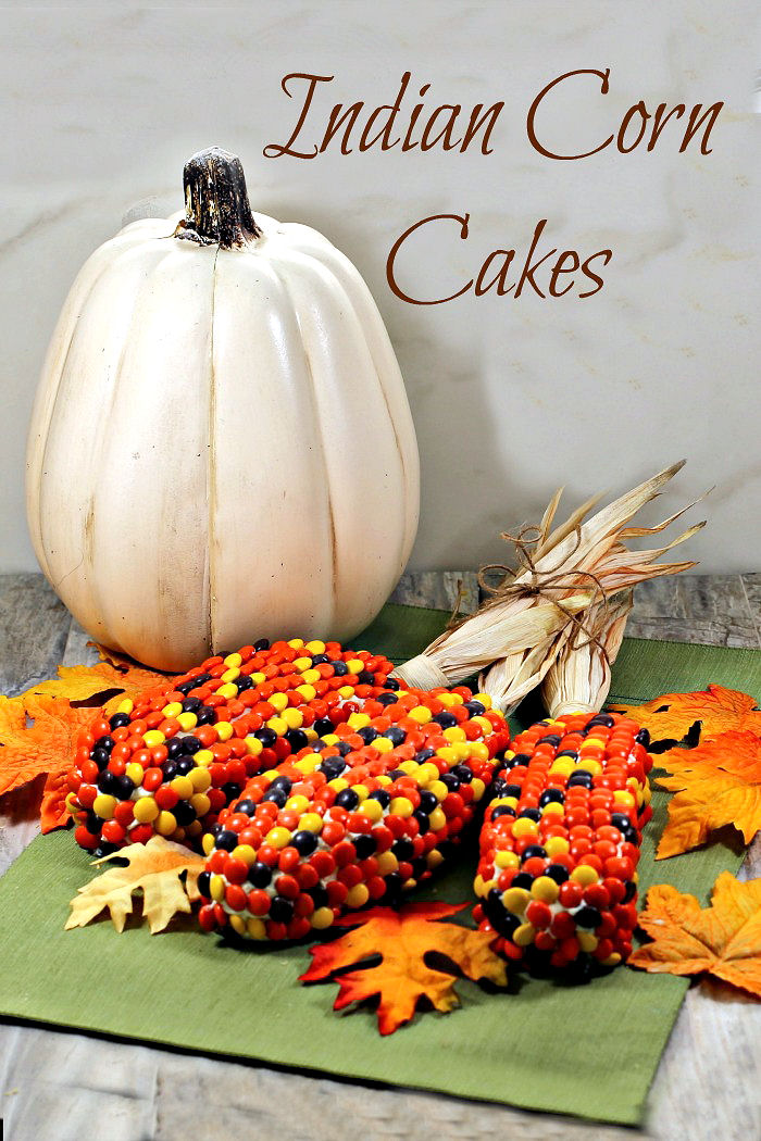 "Display of pumpkins, leaves and colorful cakes with text reading ""Indian corn cakes."""