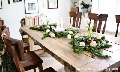 Rosemary uses as a table decoration at Christmas time on a wooden table.
