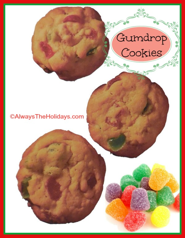 Three festive Christmas gumdrop cookies floating in the air above a pile of gumdrop candies.