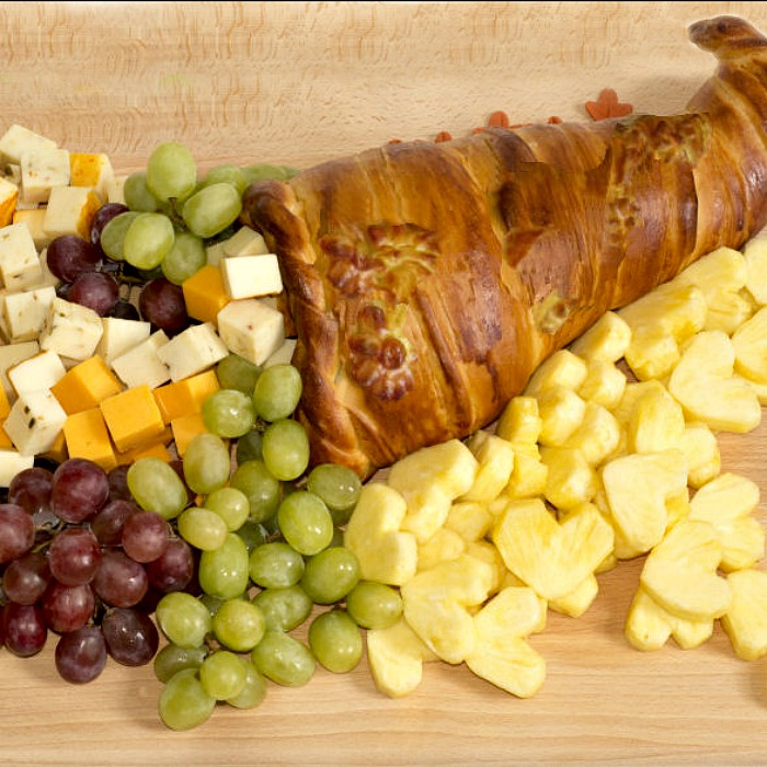 Fruit cheese and a baked cornucopia.