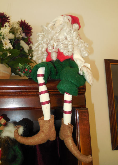 Sitting Santa Claus  elf on a shelf