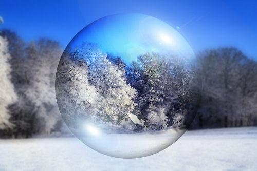 Winter scene thorugh a glass ball