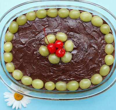 Coconut chocolate dessert with grapes for luck