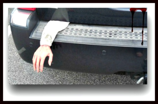 Spooky hand in the back of a car