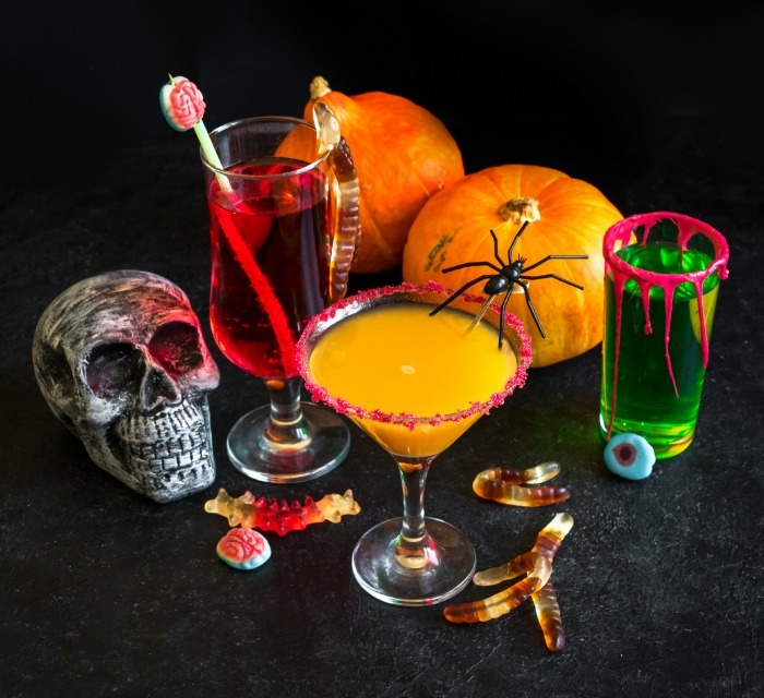 Halloween cocktail garnishes and skull.