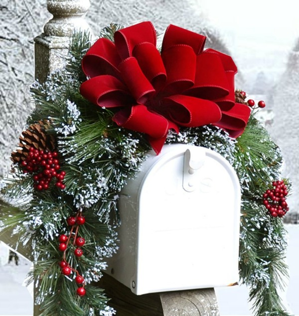 White mailbox with a red holiday swag