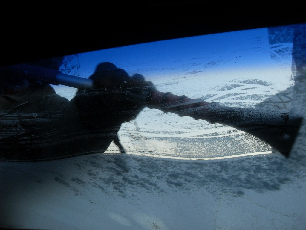 Heating your car and scraping the ice is still the best way to get the ice off.