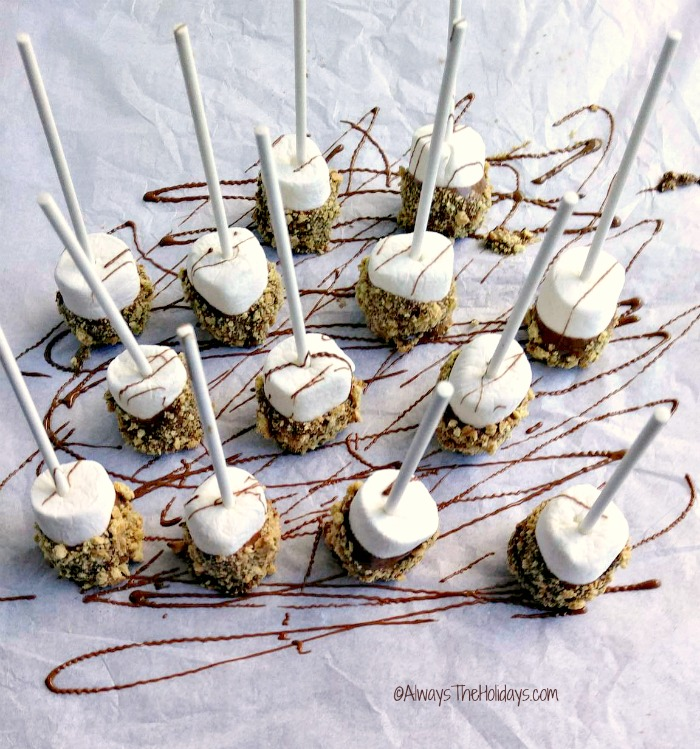 Place s'mores on paper and drizzle in chocolate