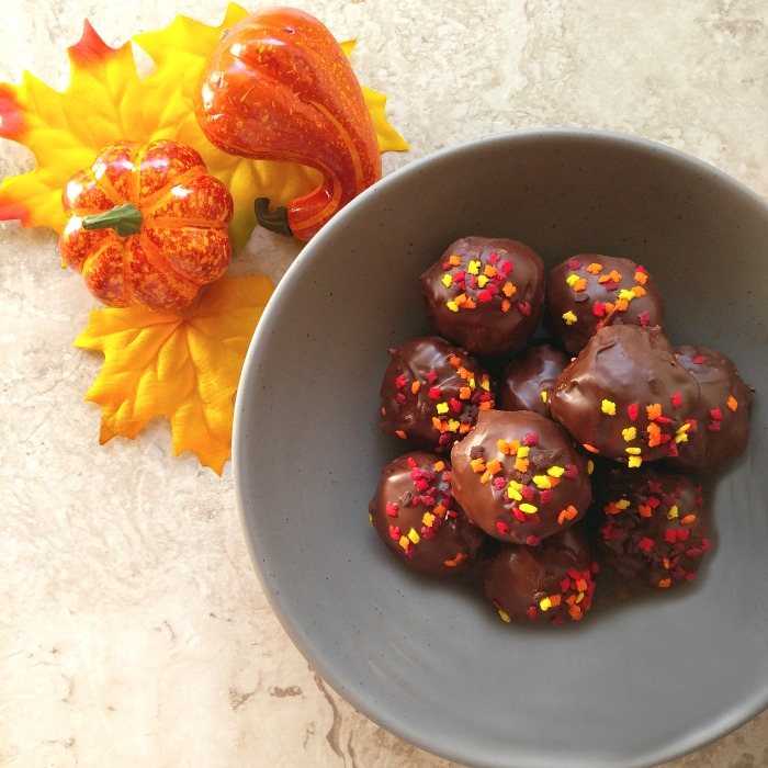 Theses peanut butter chocolate truffles have a lovely coating of chocolate with some autumn leaf sprinkles. I love the texture that flax seeds and chia seeds add to the mixture.