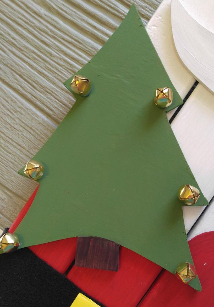 Add some jingle bells to the Christmas tree