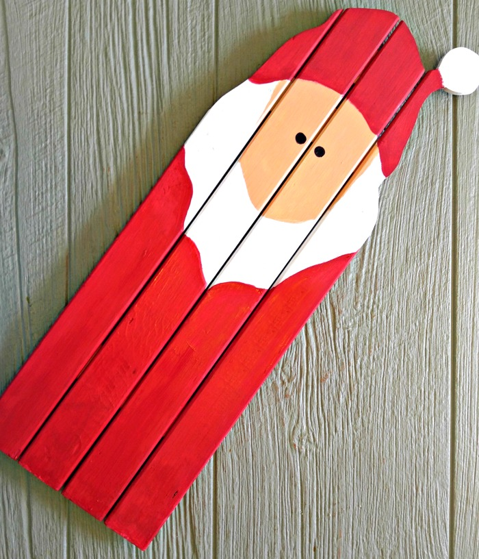 Paint the boards and face of the Santa Claus