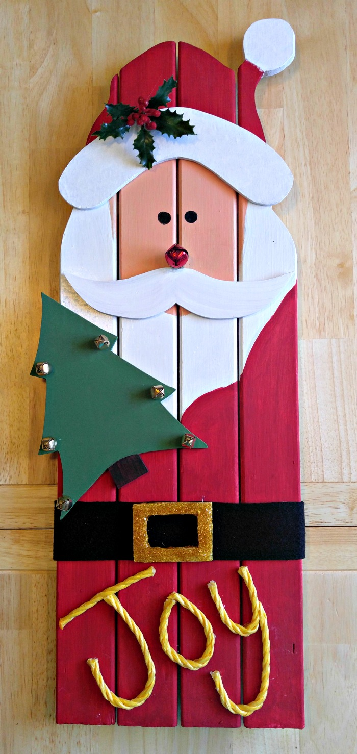 This reclaimed wood Santa decoration is made from left over wood from an old door frame. He adds a nice rustic Christmas decoration to your holiday decor.