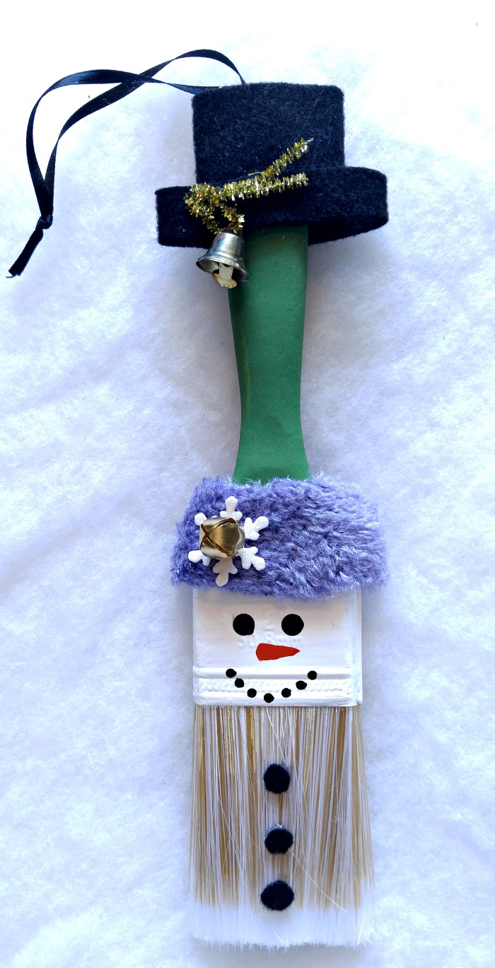 This adorable Snowman Paintbrush Ornament is sure to become a family favorite. It is easy to make and can be hung on a tree or used as a wall hanging.