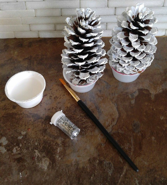 Paint the pine cones and add glitter