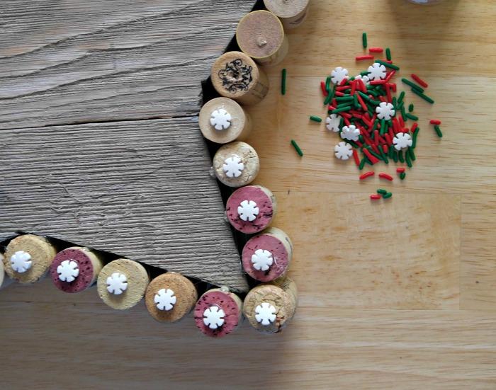 Wilton snowflakes cover the corkscrew hole