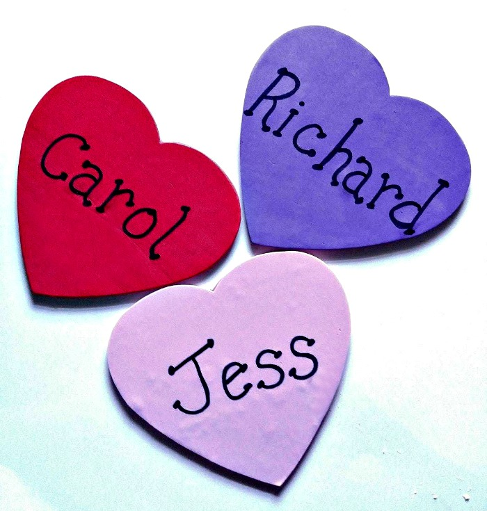 attach foam shapes to the wooden hearts