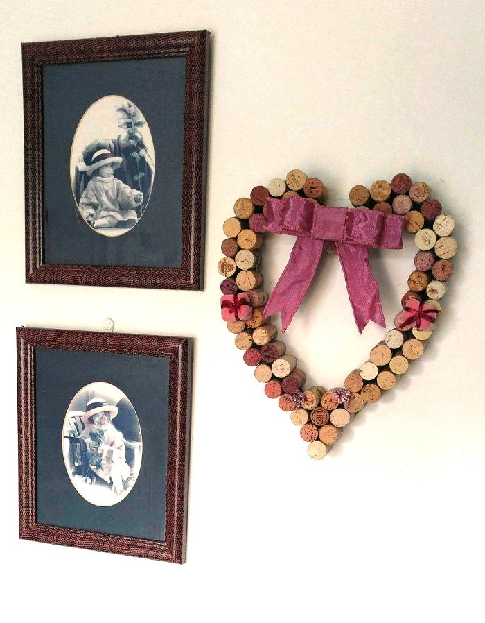 Wine Cork Heart Wall Hanging Displayed with photos of my daughter