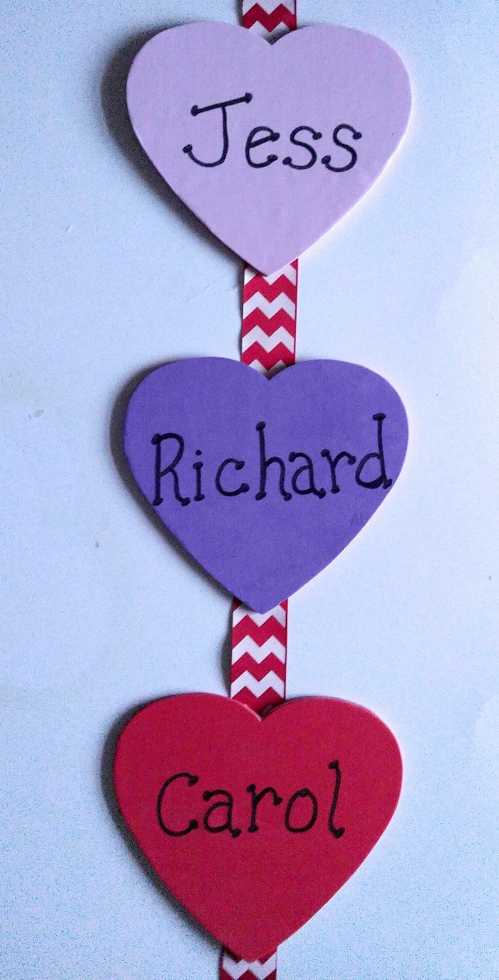Space the foam wooden hearts evenly on the ribbon