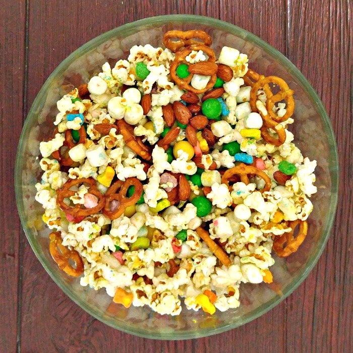 Bowl of Lucky Charms snack mix with popcorn, pretzels, marshmallows and candy.