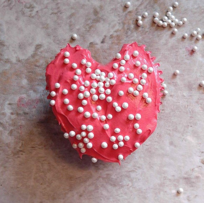 Heart shaped cupcake with pearl sprinkles