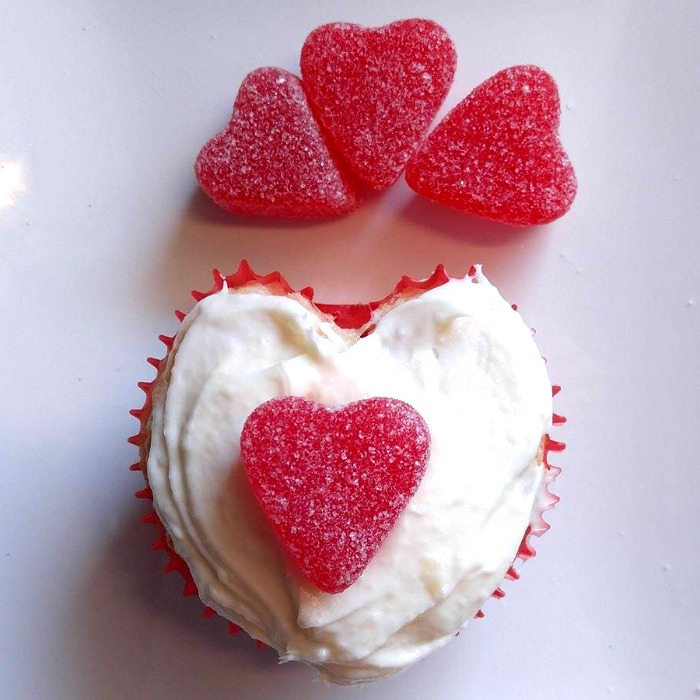 Add a cherry jelly heart to a heart shaped cupcake