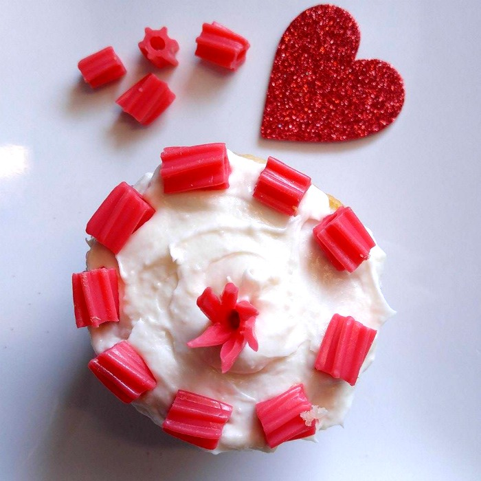 Cut Twizzlers into pieces and decorate a cupcake with them.