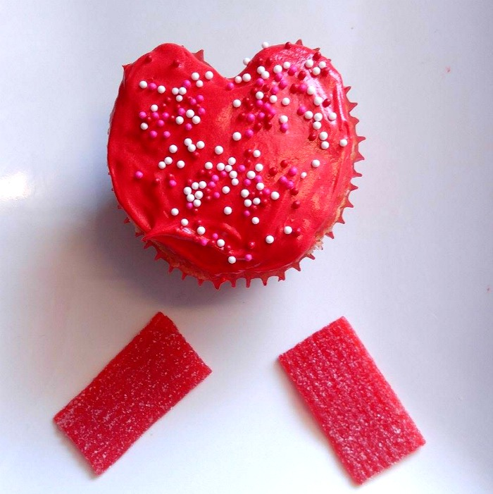 Sprinkles on a red frosted Valentine Cupcake