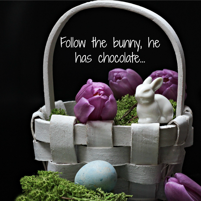 Funny Easter quote over a grey basket with purple tulips, moss and a white porcelain bunny in it.