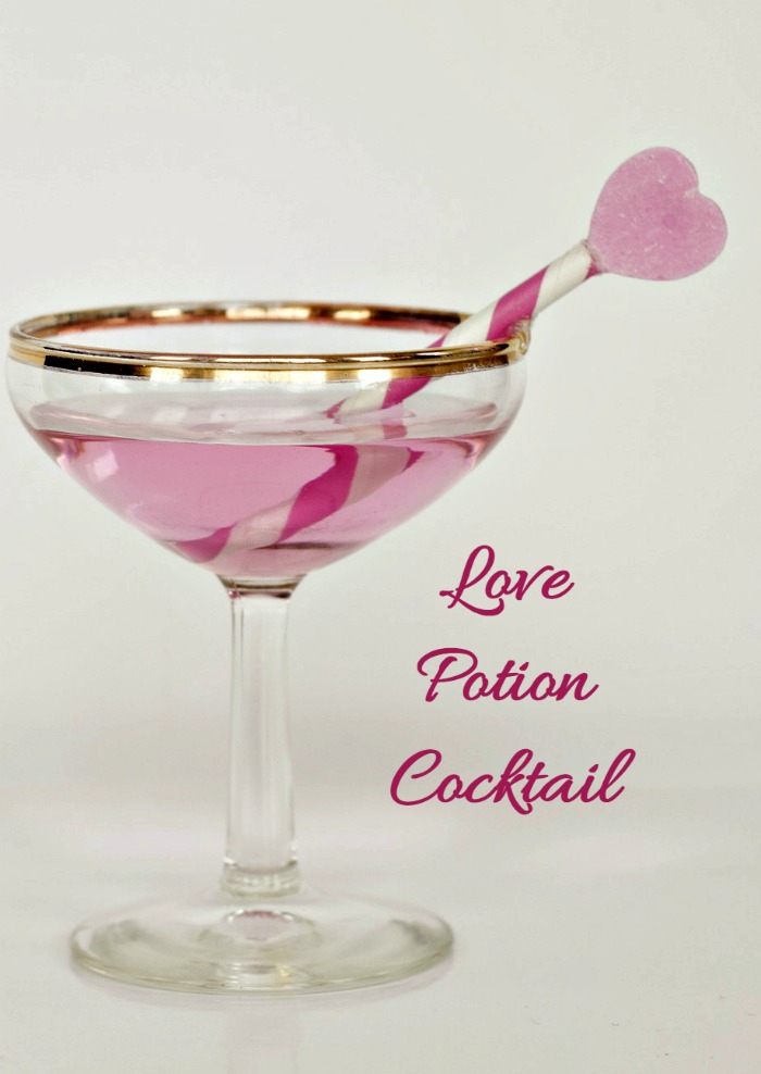 This Love Potion Cocktail is so pretty and romantic. Garnish it with a candy heart and a striped pink straw.