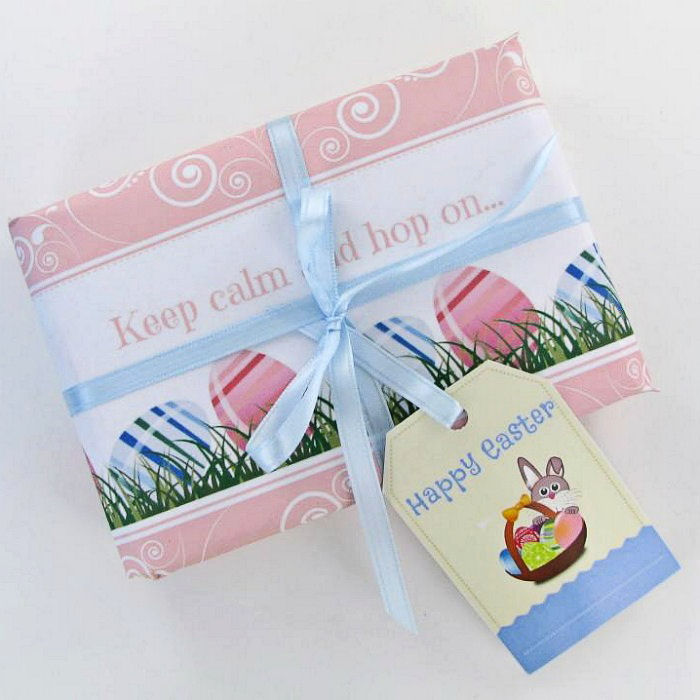 A wrapped Easter gift with an Easter gift tag on it.