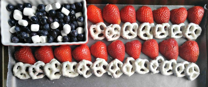 Layer the strawberries and yogurt pretzels for stripes