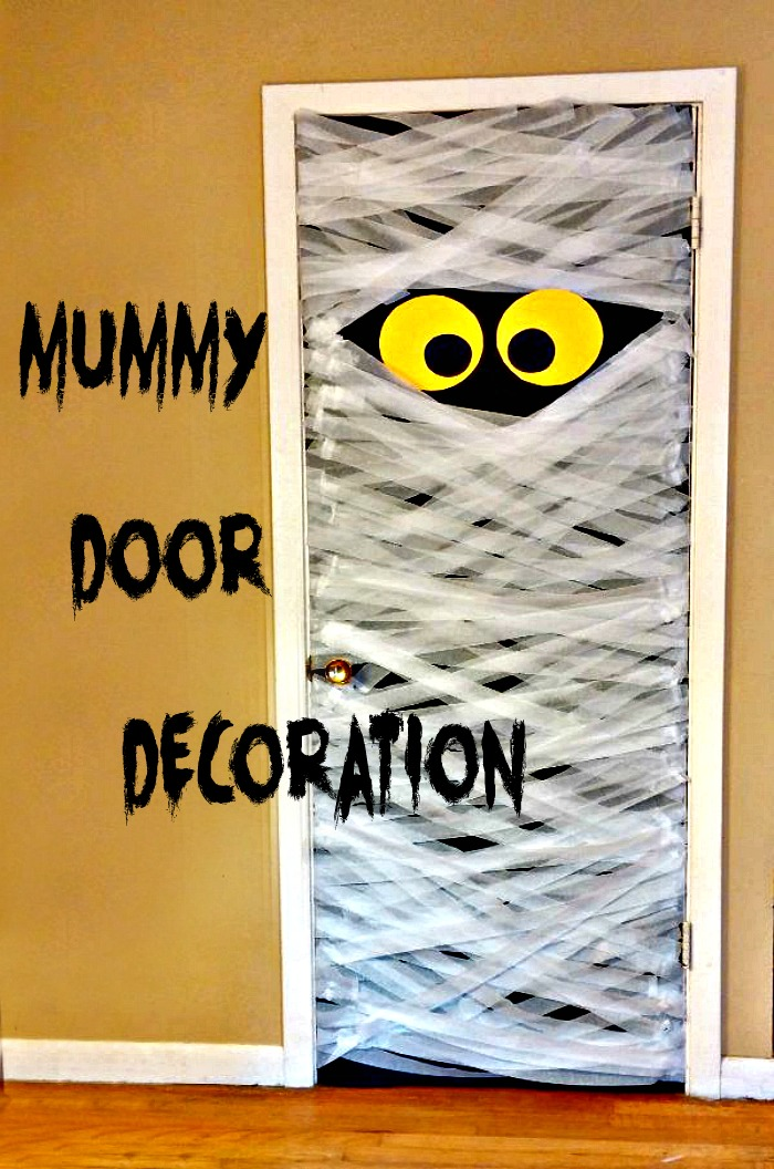 "Halloween door decorations - Closet door covered in white streamers with eyes and the words ""Mummy Door Decoration."""