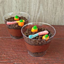 Dirt cups with gummy worms and pumpkins