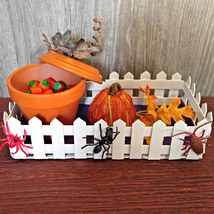 Pumpkin candy dish in graveyard