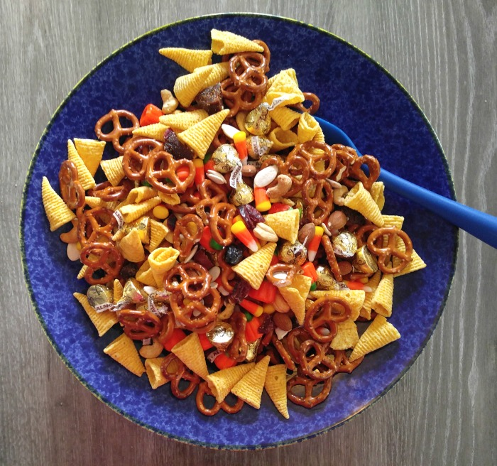 Mixing up the trail mix with pretzels, nuts, candy, dried fruit and Bugles snacks.