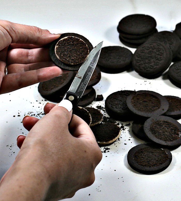 Removing creams from the Oreo cookies.